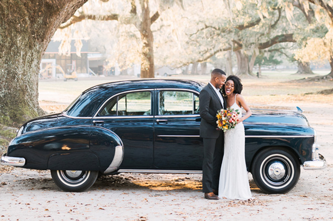 Couple in front of 1950 Chevy Styleline