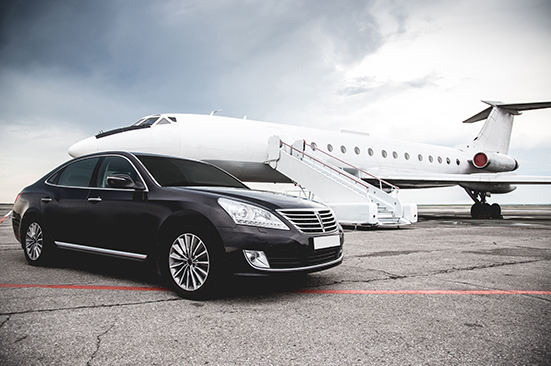 Executive car in front of airplain