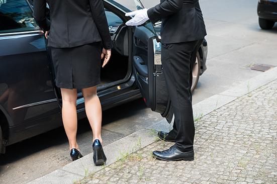 Executive getting into car