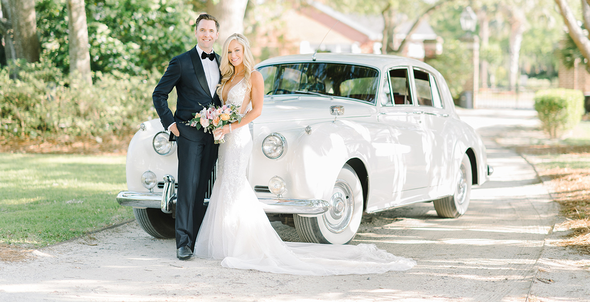 Couple in front of 1950 Packard