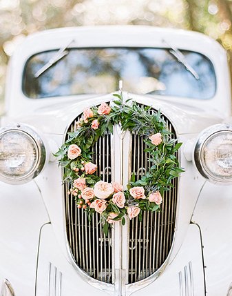 Wreath on front of car